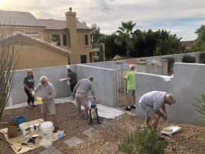 NPOA volunteers working on wall repairs