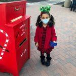 a child at the Santa mailbox
