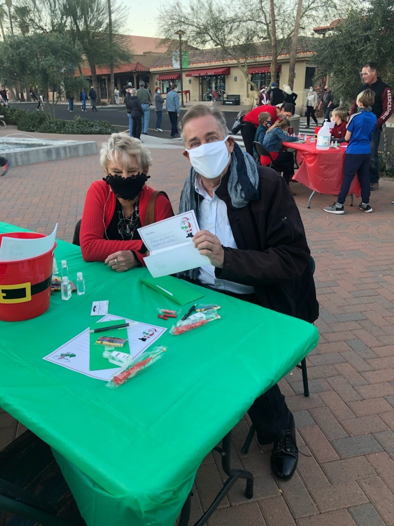 parents helping at the Santa letter table